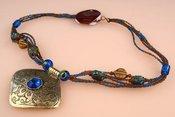 Kaklo papuošalas-pakabukas mėlynias atspalviais 18043