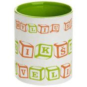 Dviejų spalvų puodelis. Šviesiai žalias vidus ir rankenėlė